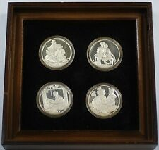 """The Four Seasons by Norman Rockwell"" Sterling Silver Medal Set in Wooden Frame"