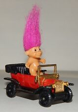 LIttle troll doll driving a Tomica 1977 Tomy type T Ford car Made in Japan