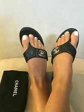 CHANEL Black Quilted Leather CC Turn Lock Clogs Slides Sandals