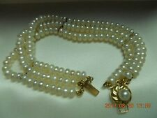 3 ROW PEARL BRACLET WITH 14K GOLD SPACERS AND 14K GOLD PEARL CLASP 7 1/2'