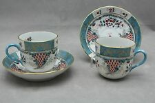 PAIR HEREND CORNUCOPIA CUP AND SAUCERS, 1727 TCA