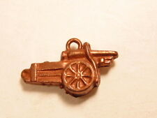 Older copper colored metal charm showing cannon or gun on cart