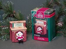 "1990 Hallmark Ornament ""Welcome, Santa"" coming down chimney Features Movement"