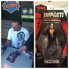 AUTOGRAPHED IMPACT STING FIGURE