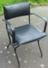 very rare leather ARMCHAIR, saddle stitching of Jacques ADNET