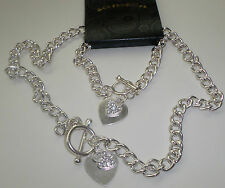 A BEAUTIFUL TWO PIECE SILVER COLOURED CRYSTAL HEART NECKLACE & BRACELET SET