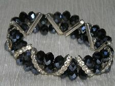 Elegant Black Faceted Aurora Borealis Bead with Clear Rhinestone Accent Stretch