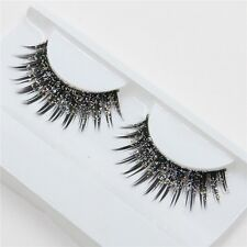 a pair of loaded nightclub makeup exaggerated fashion glitter, fake eyelashes fa