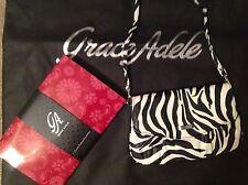 Brand New Grace Adele Elegant Jane Zebra Clutch with tags on