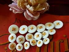 Lote de beaux botones nuevos ,alta couture blancos ,baño de oro 18piéces oferta