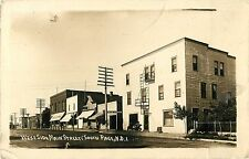 A Sunny Day on the West Side of Main Street, South Page ND RPPC 1915