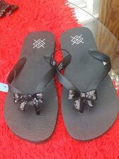 Fun pair of ladies UK 9 / EUR 43 black wide flipflops with a sequin bow detail