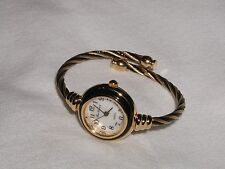 TWISTED WIRE WATCH BLACK & GOLD NICE FOR A PETITE WRIST EASY TO READ NEW !