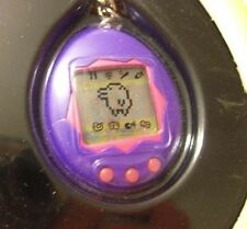 1997 BANDAI ENGLISH TAMAGOTCHI PURPLE VIRTUAL PET *NEW* ELECTRONIC GAME KEYCHAIN