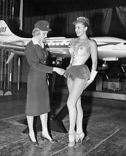 1959  Swedish stewardess showing off sexy new hostess ataire  8 x 10 Photograph