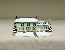 Norman Rockwell's Home for the Hoildays - Bringing Home the Tree Figurine