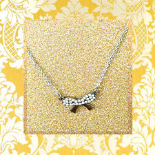 "CC20110 - ""silver"" pendant with shimmering bow stainless steel pendent"