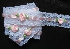 1 1/4 inch wide white lace with satin roses  selling by the yard