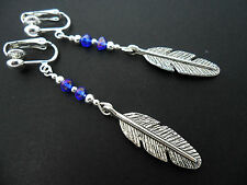 A PAIR OF  TIBETAN SILVER LONG DANGLY  FEATHER THEMED CLIP ON  EARRINGS. NEW.