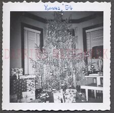 Vintage Photo Tinsel Christmas Tree in Home Interior 648913