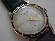 Vintage Man's Swiss made Bulova in with honeycomb dial and black enamel bezel