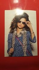 Photograph of Selena Gomez with signed Autograph