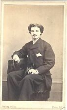CIVIL WAR ERA PORTRAIT OF WELL-DRESSED YOUNG MAN HOLDING A CAP or SHOE