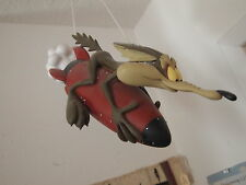 Wile E. Coyote on a rocket statue