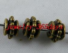150 Gold/Bronze Color Bail Style Spacer Beads 7x5mm 694