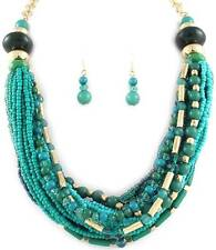 MULTI STRAND TEAL GLASS SEED BEAD LUCITE BEAD GOLD TONE LINK NECKLACE SET