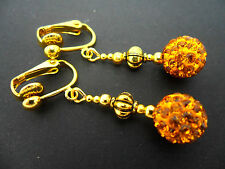 A PAIR OF DANGLY GOLD PLATED GOLD SHAMBALLA STYLE CLIP ON   EARRINGS.