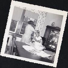 Old Vintage Antique Photograph Woman Fixing Man's Hair in Retro Dining Room