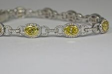 18k White Gold Fancy Intense Yellow Oval Diamonds And White Diamond Bracelet 7