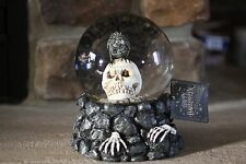 LIGHT UP SKULL (EYES) WITH A BLACK BUZZARD RESIN BASE W/  BLACK SNOW GLOBE
