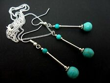 A PRETTY TURQUOISE  BEAD NECKLACE AND  EARRING SET. NEW.