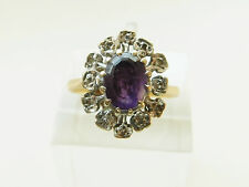 A BEAUTIFUL SOLID 18ct GOLD DIAMOND AND AMETHYST STONE SET RING