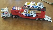 majorette number one tractor trailer car hauler with 2 race cars