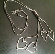 Lagenlook, Abstract, silver,  serpent necklace, with 4 tiered hearts, necklace.