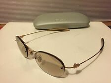 New DKNY 7256S (715) Sunglasses, Gold / Bronze with Lite Black Mirror Lens
