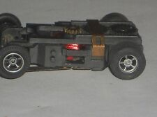VINTAGE AURORA AFX MAGNA TRACTION CHASSIS HO SLOT CAR RUNS GREAT