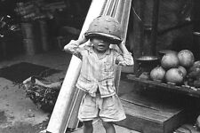 Vietnam 1971- Vietnamese Boy Putting On Army Headgear