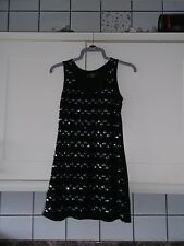 LADIES DRESS OR TOP SIZE SMALL BLACK WITH SMALL RUFFLES AT FRONT AND SEQUINS