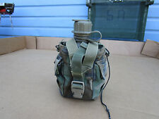 MILITARY SURPLUS PLASTIC 1 QUART WATER CANTEEN AND WOODLAND CAMO COVER