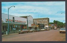 Ben Franklin store street scene of Iron River Michigan MI cars autos postcard