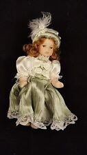 Small Bisque Porcelain Doll - Green and White Dress