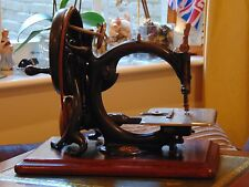 An eatly Wilcox and Gibbs sewing machine in original painted case