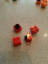 4 LEGO dust caps in city, friends and minecraft colours. Will mix or send same