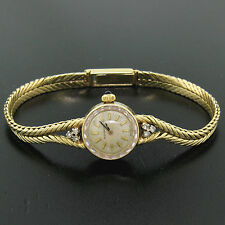 Vintage Ladies Movado 14k Solid Yellow Gold .18ctw Diamond Mechanical Watch