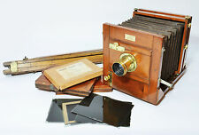 Victorian ½ plate folding field camera by Underwood, with tripod and accessories