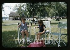 1950s red border Kodachrome photo slide Young Girls in chair at park